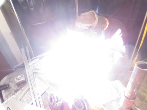 Welding is hard to take pictures of, unless there's a lot of sparks. In which case you have a sparkly picture. This, however, is TIG on aluminum--no sparks, but a lot of light.