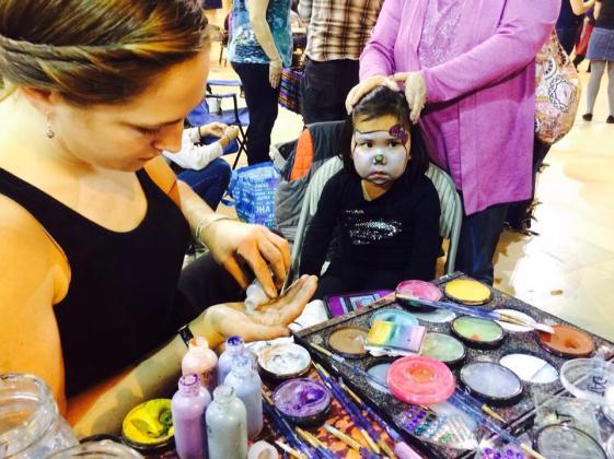 Sarah Glaser face painting Seward Music and Arts Festival Alaska