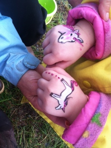 She wanted a daddy unicorn and a baby unicorn on each hand. Too cute.