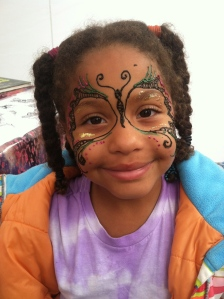 She wanted a henna butterfly on her face. I added glitter.