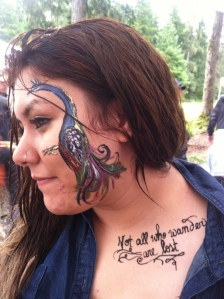"I love peacocks. And so does she. Also, in henna: ""not all who wander are lost."""