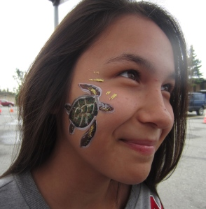 Sea turtle face painting. She could hardly keep from laughing while I was painting her.