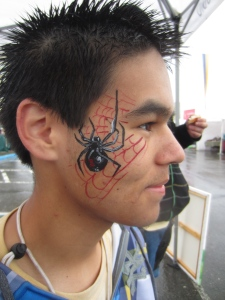 Black widow face painting. Complete with web!