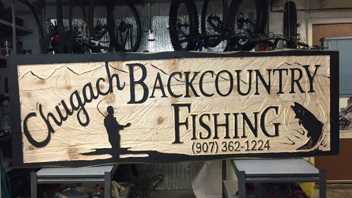 Sarah Glaser's sign for Chugach Backcountry Fishing in Moose Pass, Alaska